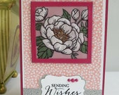 Birthday card - coloured and embossed vellum in red and pink with silver glitter embellishments