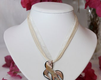 Multistrand cream necklace with gorgeous shell pendant.