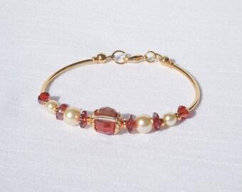 Swarovski red magma crystal, Swarovski light gold pearl and gold bracelet