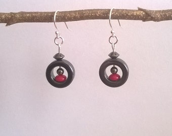 Funky little earrings with black, red and silver beads and sterling silver ear wires.