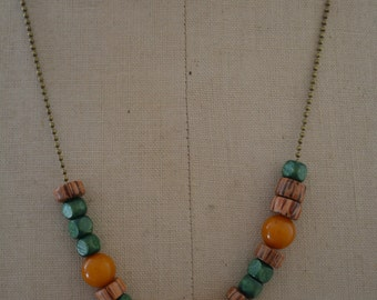necklace, wood beads and beads of amber