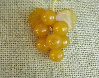 Vintage bakelite grape cluster brooch, gold,1940