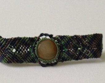 Navy blue, brown, and green micro-macrame bracelet with yellow stone