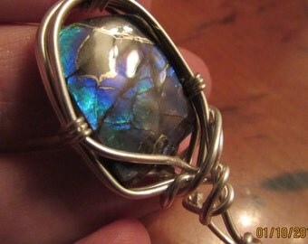 """ammolite gemstone pendant wrapped in sterling silver wire. """"robins egg"""""""