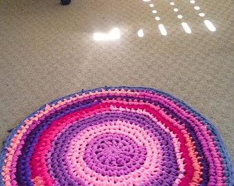 Rag Rug, round t-shirt rug in pinks, purples, and reds.
