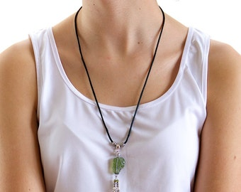 Green seaglass pendant «Swaddled»