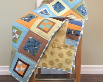 Dino Patchwork Baby Quilt