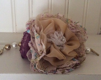 Champagne and aubergine fabric flower wrist corsage