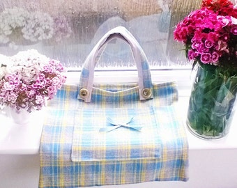 Beautiful blue and yellow plaid fabric bag with front pocket!