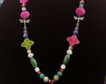 Long, colorful, groovy, beaded necklace 16 inches long