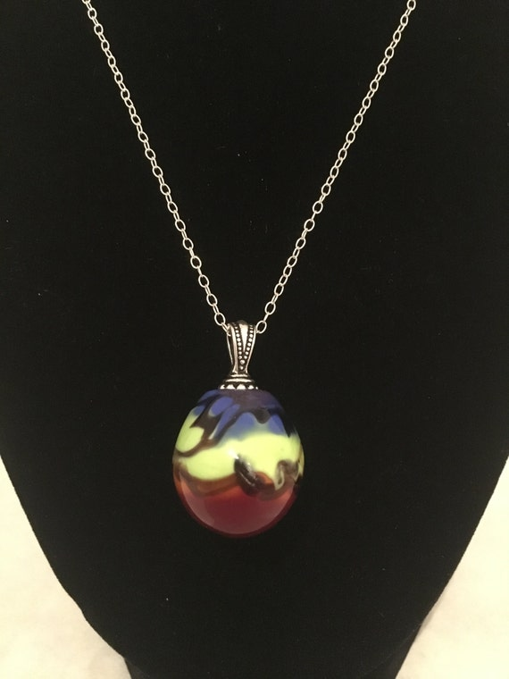 Tri colored Venetian style blown glass bead strung on sterling silver