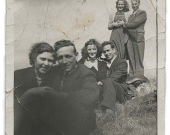 Dynamic vintage snapshot of 3 couples 1940's