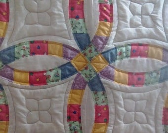 Double wedding ring quilted wall hanging