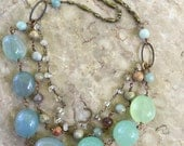 Chalcedony, jasper and aquamarine wire wrapped multistranded necklace with brass
