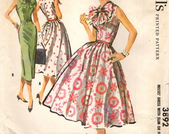 McCall's 3892 Beautiful Bow Framed Neck & Face Sheath or Full Skirted Dress ©1956