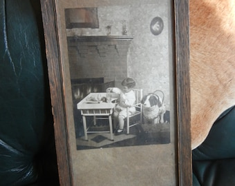 Framed antique 1920s photo of child playing with toys