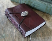"Leather Journal - Emily Dickinson quote: ""We grow not older with years, but newer every day"". burgundy . handmade handbound (320 pgs)"