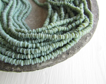 Mini tiny  green rondelle lampwork glass beads, delicate, opaque  semi matte, Indonesian ethnic 1 to 1.5 x 3mm ( 22 inches strand ) 7BB13-1