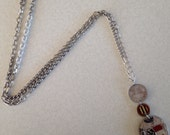 German necklace. Phoenix necklace. Striped necklace.