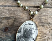 long vintage pearl necklace vintage mother and child swan illustration oval antiqued gold pendant chippy pearls graceful mothers day gift