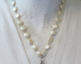 Sterling Sugar Shell Necklace.  Weren't born with a silver spoon in your mouth?  Me neither -- it's prettier on your neck anyway. Kay Adams
