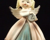 Beautiful Vintage Inarco Angel Figurine Hand Painted Holding Clock Muted Soft Pink Blue Color Numbered Paper Label ATCTTEAM TNTEAM