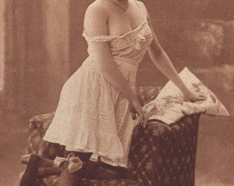 Semi-Nude Lingerie Model with a Big Bow, circa 1910s