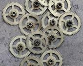 Vintage clock brass gears -- set of 12 -- D1