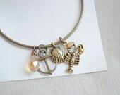 Bangle Charm Bracelet. Stack bracelet, Charm Bracelet, Lobster charm, shell charm, bronze stacking bracelet,anchor charm bracelet