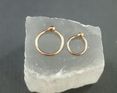 Tiny 14k Gold nose ring. 14k real gold earrings. One ring or one pair. Second hole ring. Solid gold ball earrings. Tiny Gold Nose ring hoop