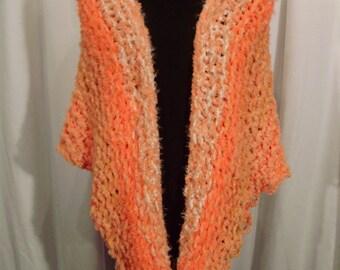 shades of orange knit shawl--Goldfish Knit Wrap
