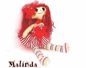 Red head cloth doll