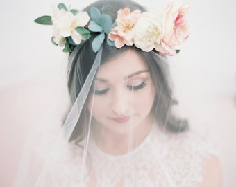 The Savannah Floral Crown created with blush pink english roses, peach and ivory blossoms and soft sage eucalyptus greenery