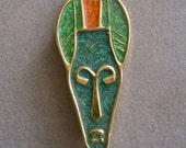 African Mask Brooch Modernist Vintage Tribal Figural Enamel on Gold Metal Turquoise Green Orange