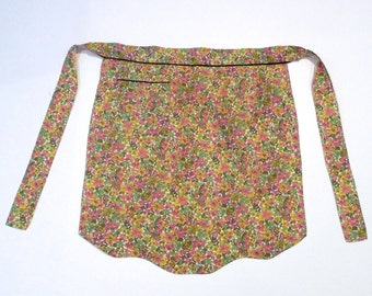 Floral apron Vintage Calico half apron 1960s 1970s Botanical hostess apron Pink Yellow Green cotton blend with front pocket Kitchen Bar Cook
