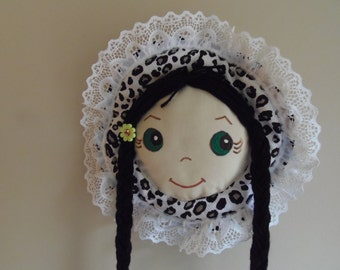 Barrette Holder organizer green eyes black hair and black white animal print bonnet lace trim with flower accent keep barrettes clips neat