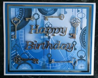 Silver Keys on Blue Keys and Pocket Watches Background Birthday Card