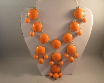 3 Row Pendant Bib Necklace with Orange Beads on a Gold Tone Chain