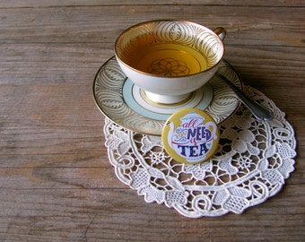 All you need is tea pin for all the tea addicted. Hand type button.