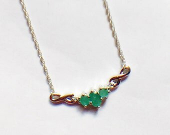 Emerald Infinity Necklace in Platinum Handmade Jewelry by NorthCoastCottage Jewelry Design