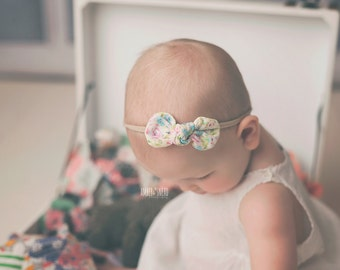 Floral knotted bow on nylon headband, one size baby headband, knotted fabric bow, newborn headband, newborn photo prop, nylon headbands