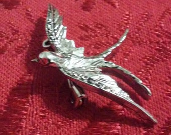 Vintage Silver tone Marcasite bird pin with red eyes