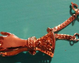 Gold tone hands glove clip