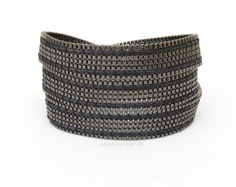 Black metal chain wrap bracelet with chain trimming on soft black polyester cord, triple wrap bracelet