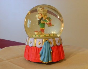Tracy Flickinger for Silvestri Musical Snow Globe. Santa Claus in the Workshop.