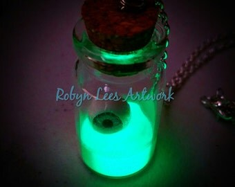 Green Glow In The Dark Radioactive Disaster Glass Bottle Jar Necklace with a Steel Grey & Pink 3D Eyeball on Silver Crossed Chain