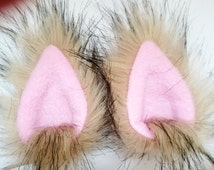 Very light brown animal ear hair clips with pink fleece clip on cat ears