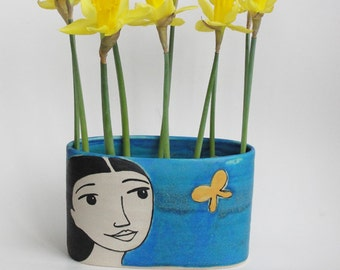 Yellow Butterflies. Decorated Stoneware turquoise pillow vase. One in stock.