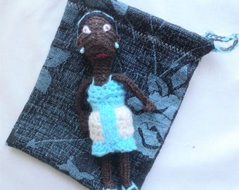 Hand Knitted Doll Wearing a Blue and Cream Dress