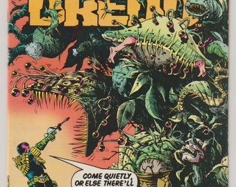 Judge Dredd; Vol 1, 4 Copper Age Comic Book. NM.  February 1984.  Eagle Comics